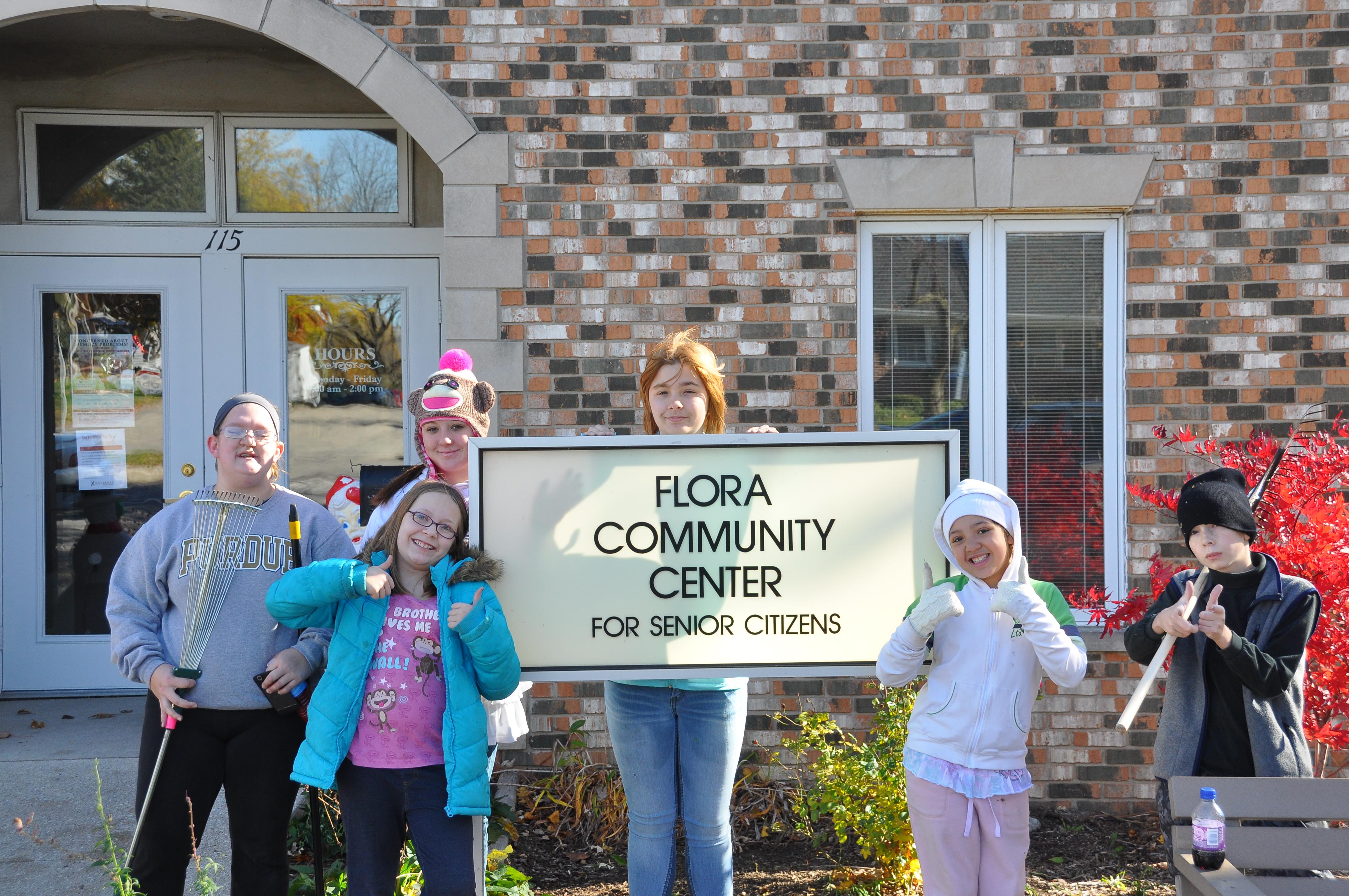 Oasis mission project — raking leaves at Flora Senior Center