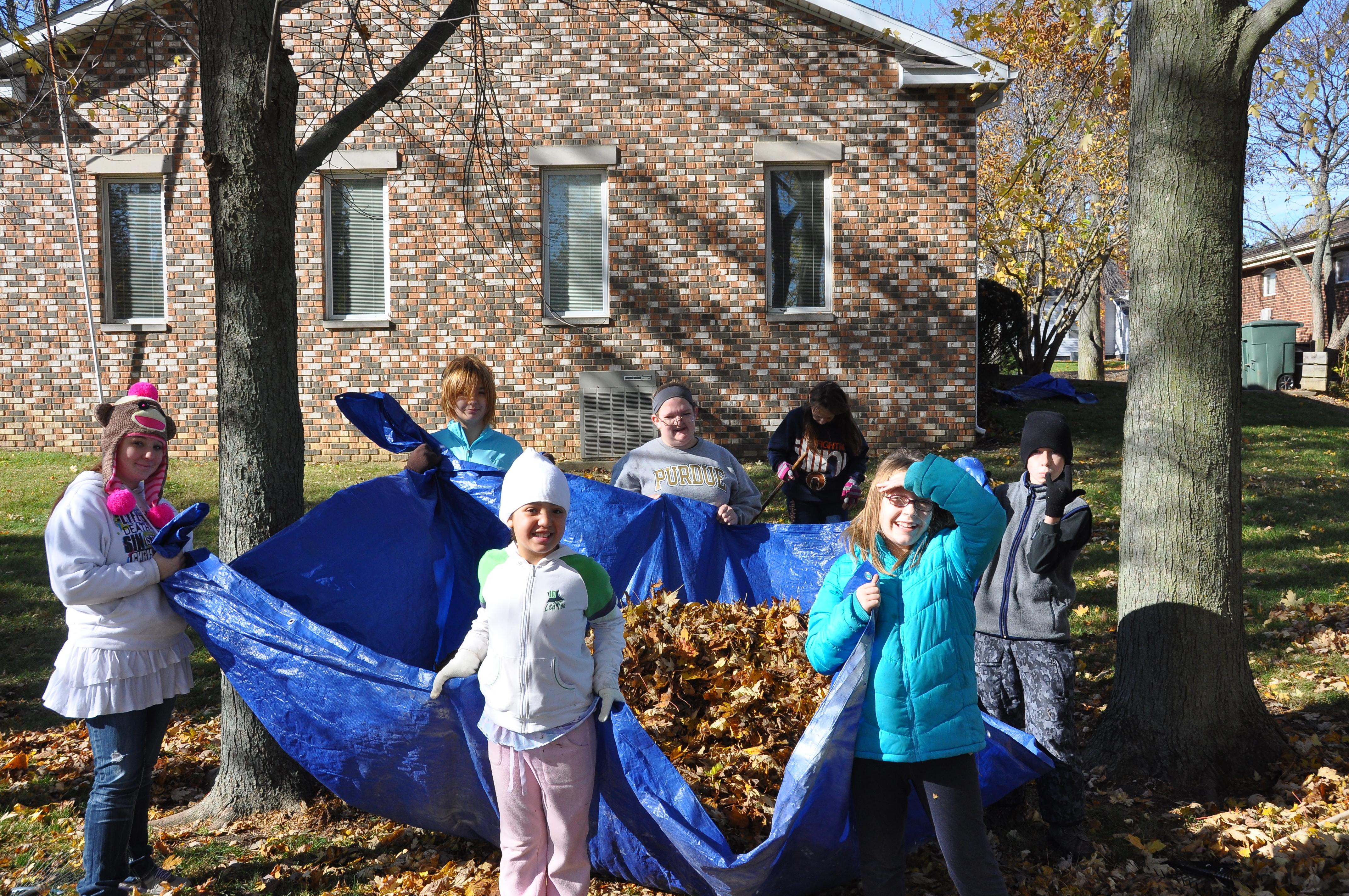 Oasis mission project — raking leaves for Flora Senior Center